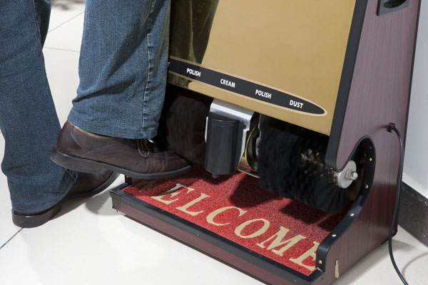 Shoe polishing machine in the lobby and on each floor